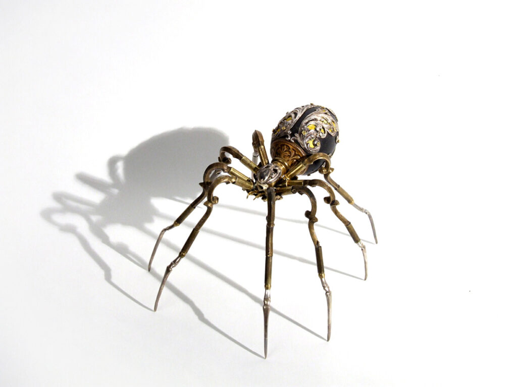 "Spider sculpture by Jessica Joslin. ""Uttu"", Antique hardware and findings, painted wood, brass, silver, steel, 5"" x 8"" x 8"""
