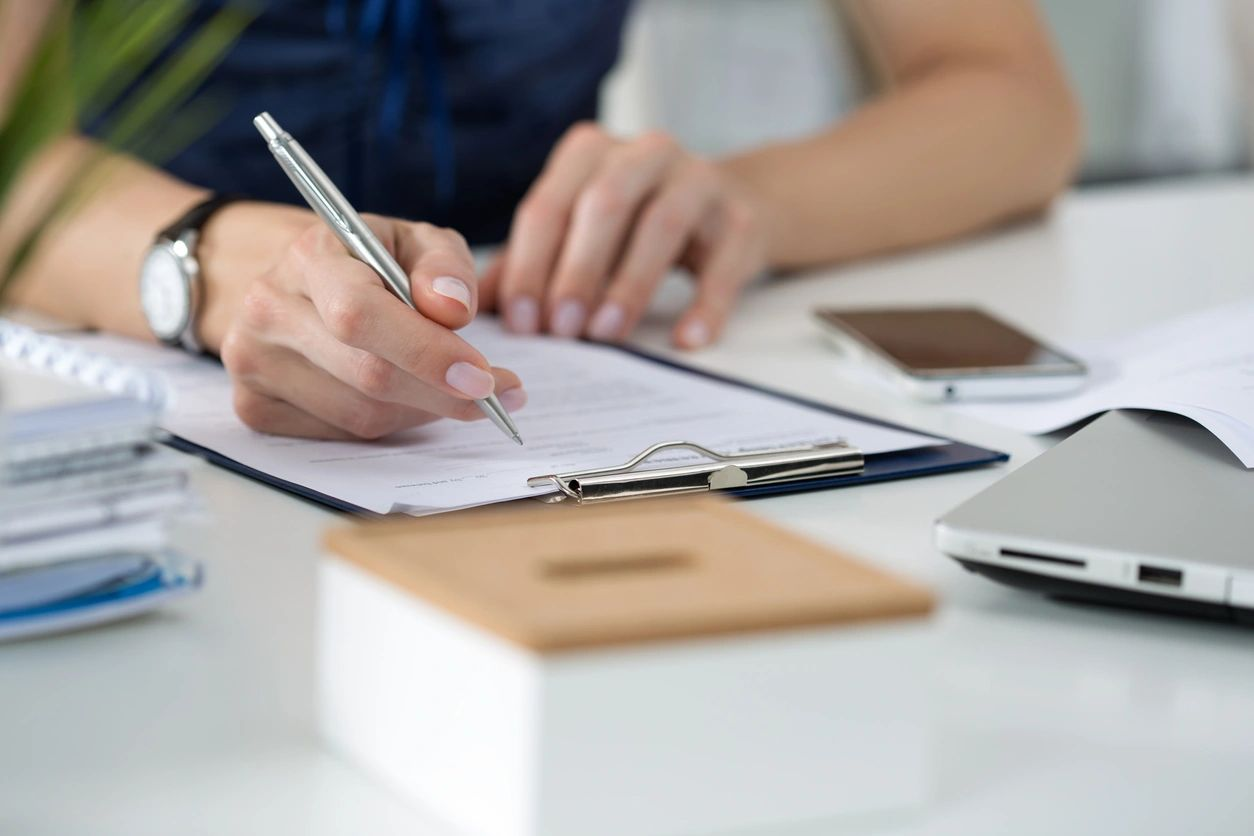 Image of someone working on paperwork