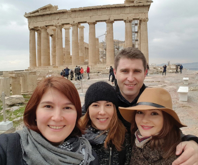 Ioana with sisters & brother­-in­-law in Greece