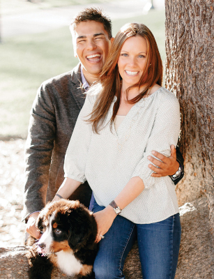Professional photo of Shelby, Troy, and dog sitting on a low tree branch