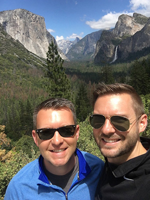 Nick and Chris in front of Yosemite forest and mountains