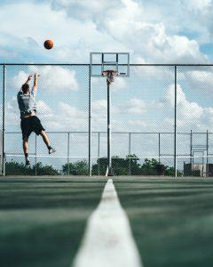 a person throws a basketball