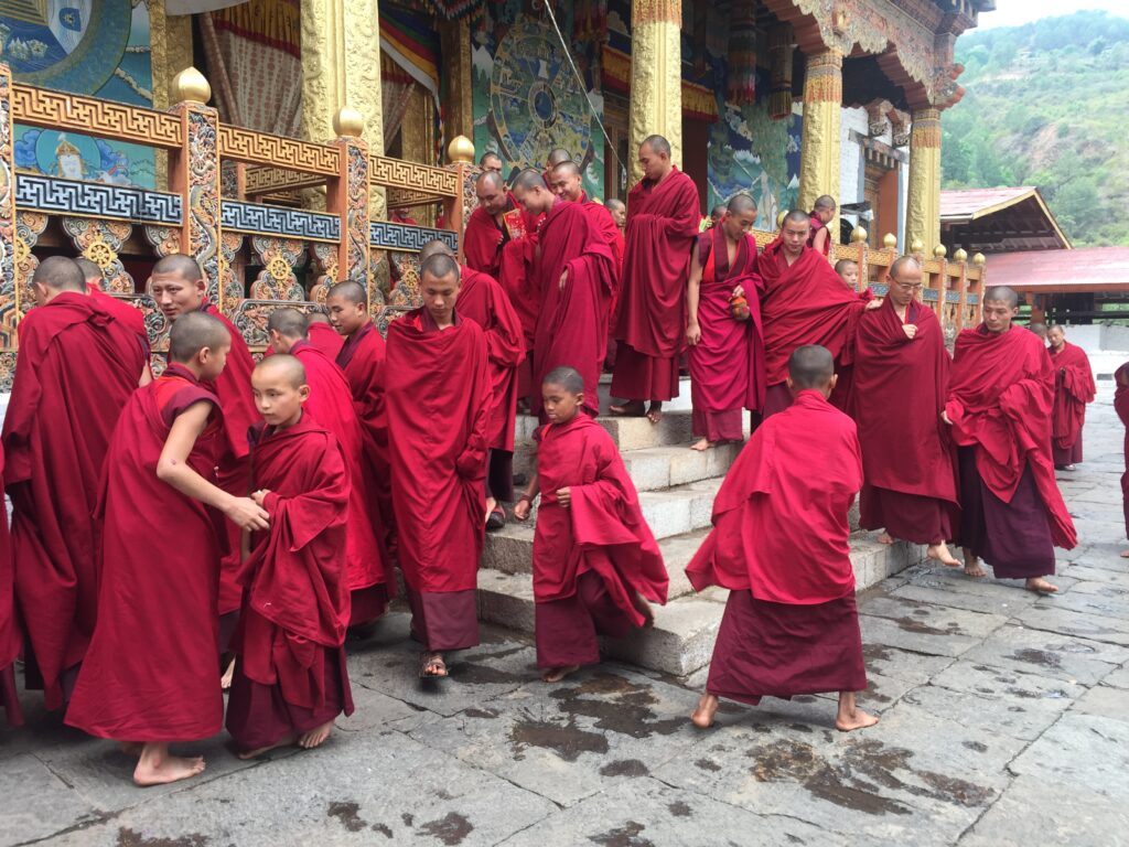 Monks gather at a ceremony in one of the massive temple structures