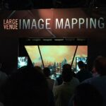 Epson InfoComm Robotic Arm and Projection Mapping Booth Experience - Crowd Observing