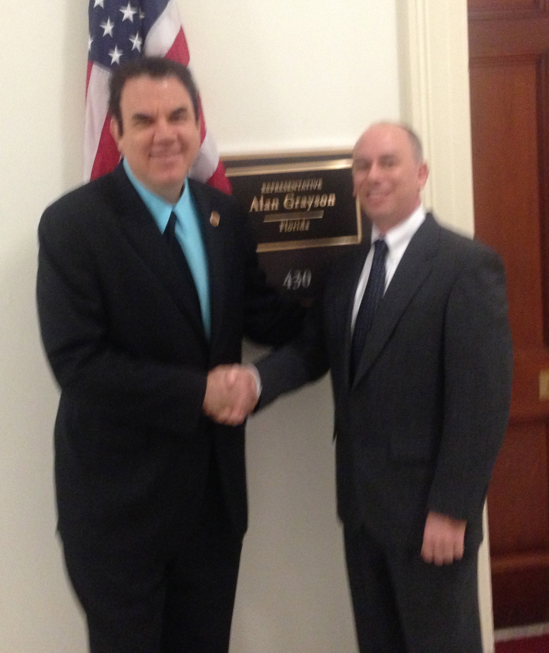 Prosthetist Brett Saunders meets with Rep. Alan Grayson as pictured on the website of Saunders Prosthetics and Orthotics Group in the Villages of Lady Lake