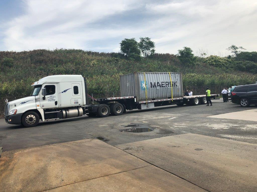 Damaged Container on Flatbed