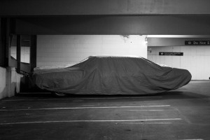 A tarp-covered car in the bowels of the Pierson-Sage parking garage. Photo by Jennifer Lu.