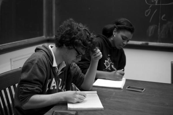 Zariah Altman and Xavier Sottile prepare for their next round of debate.