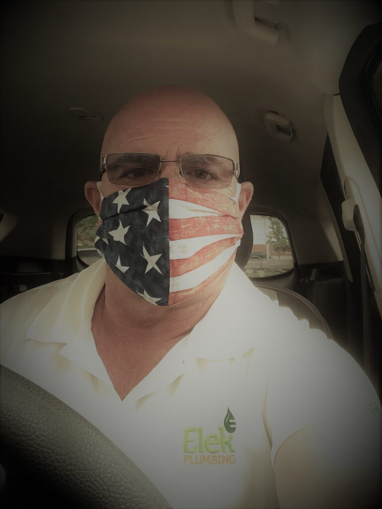 man wearing white shirt & USA masksk & sunglasses