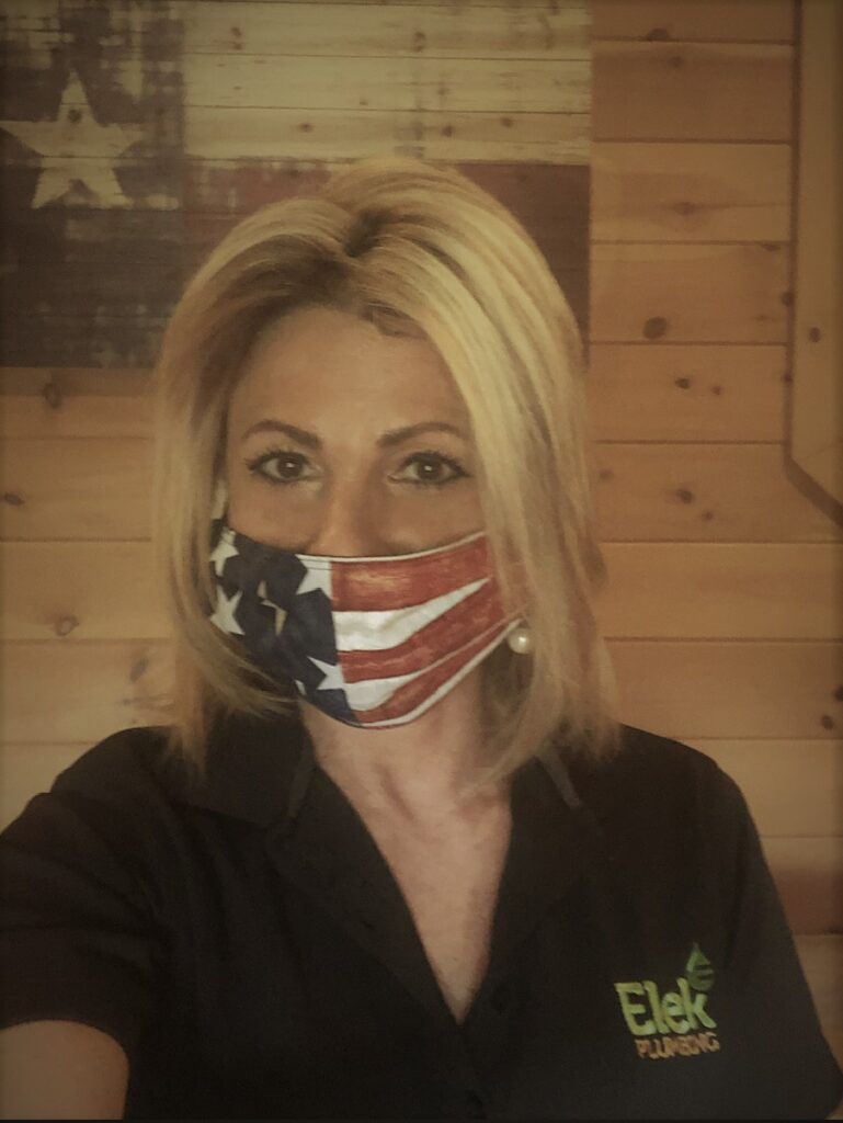 woman in black polo & USA face mask