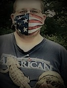 young man with USA mask holding lizard