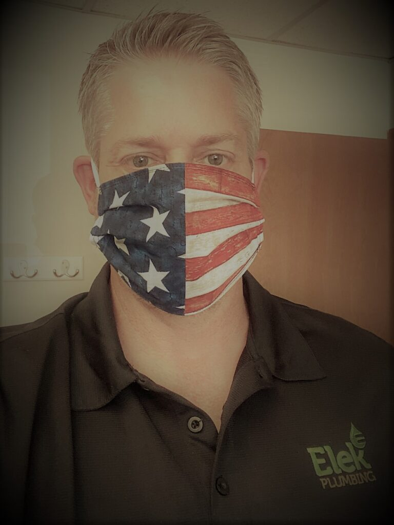 man in black polo with USA mask