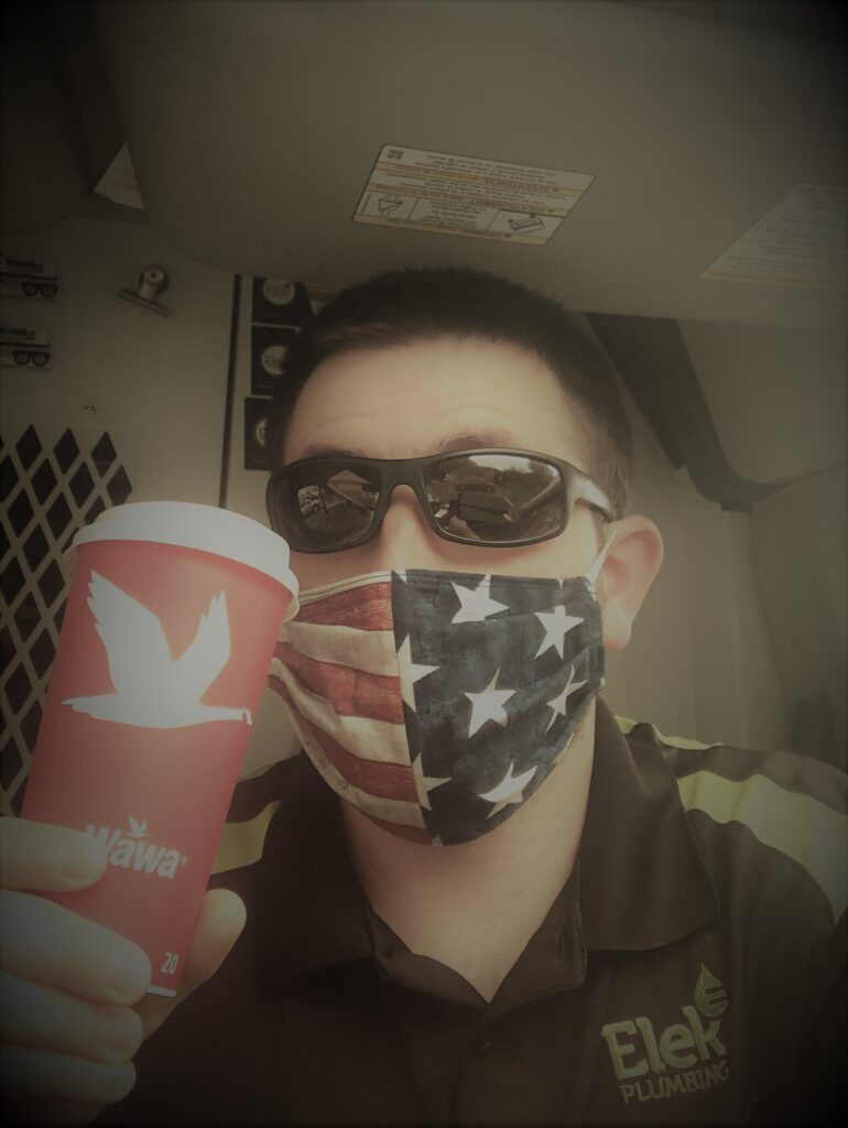 man in USA mask with coffee cup