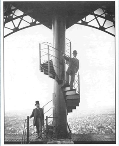 Gustave Eiffel (bottom), accompanied by a collaborator Mr. Salles at the Eiffel Tower