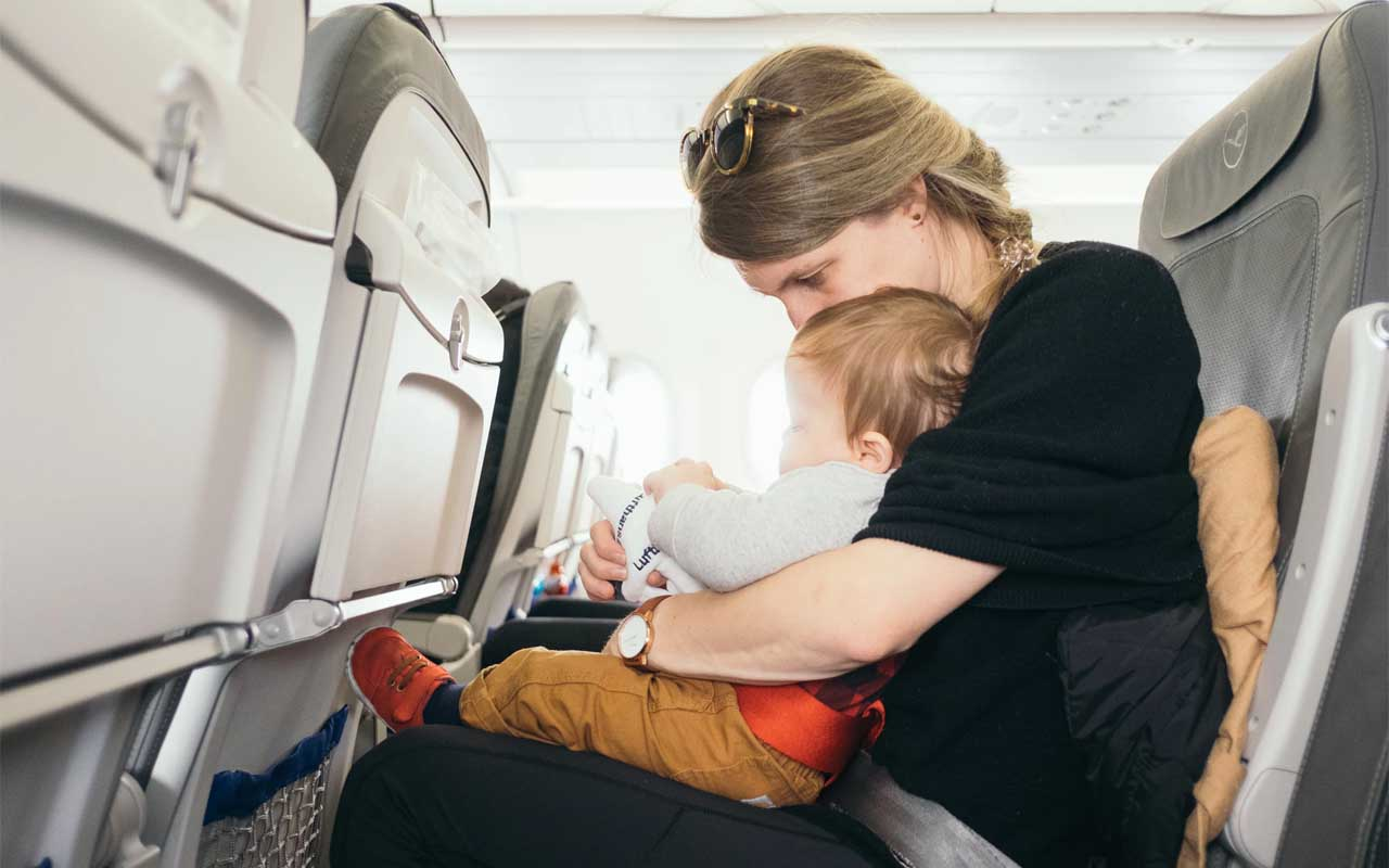 Traveling with a child in lap can be deadly, children, travel, plane, aircraft, flying