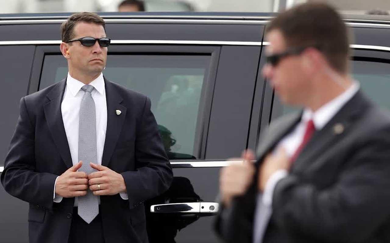 Secret Service agent, hand gesture
