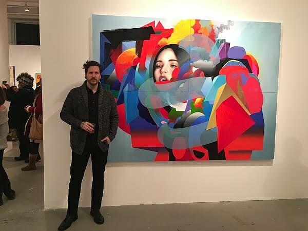 Erik Jones with artwork at opening night