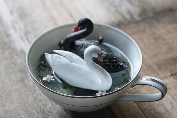 Meadow & Fawn swan resin sculpture in teacup