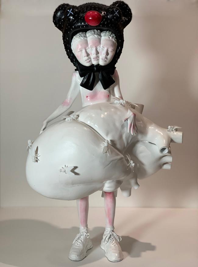 Ciane Xavier surreal 3 headed heart sculpture