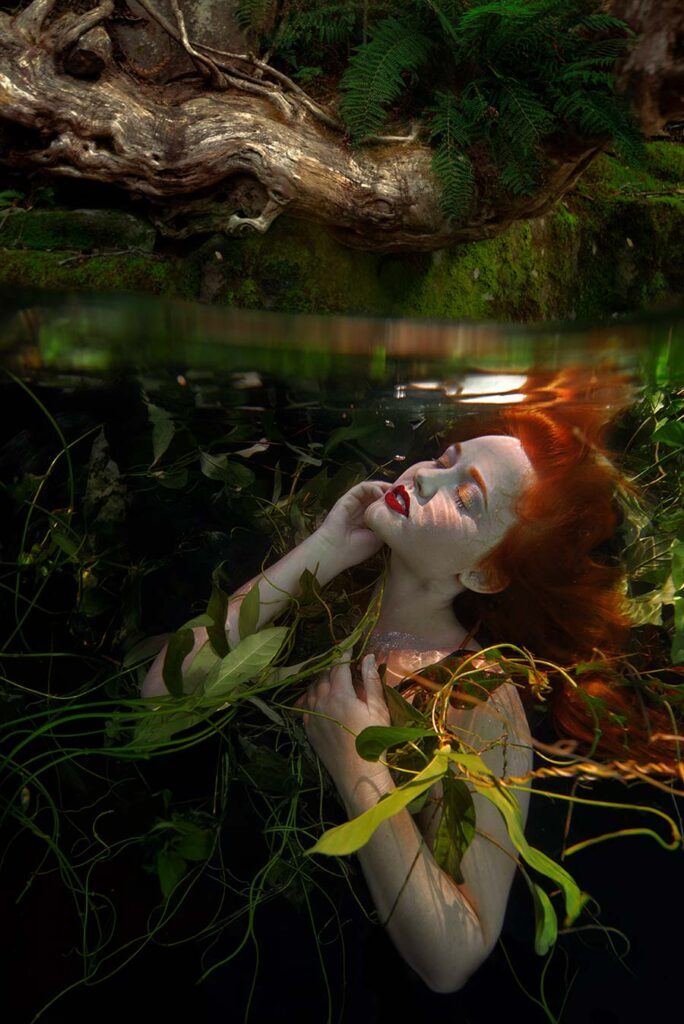 Beth Mitchell underwater red haired woman