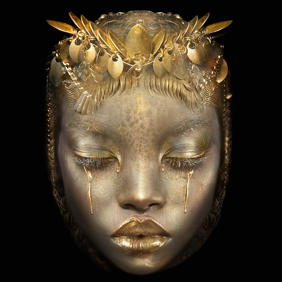 Ingrid Baars gold face woman