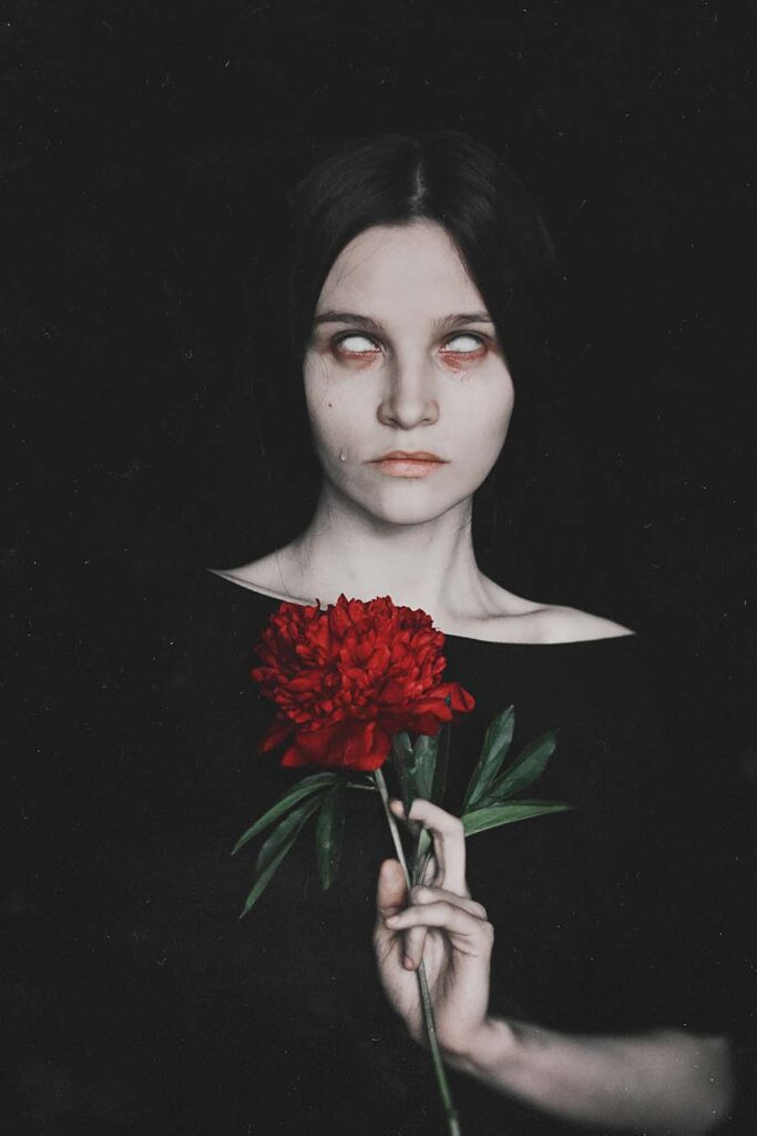 Natalia Drepina woman and red flower