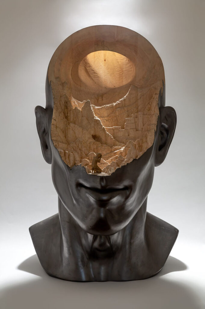 Richard Stipl carved wooden city in head