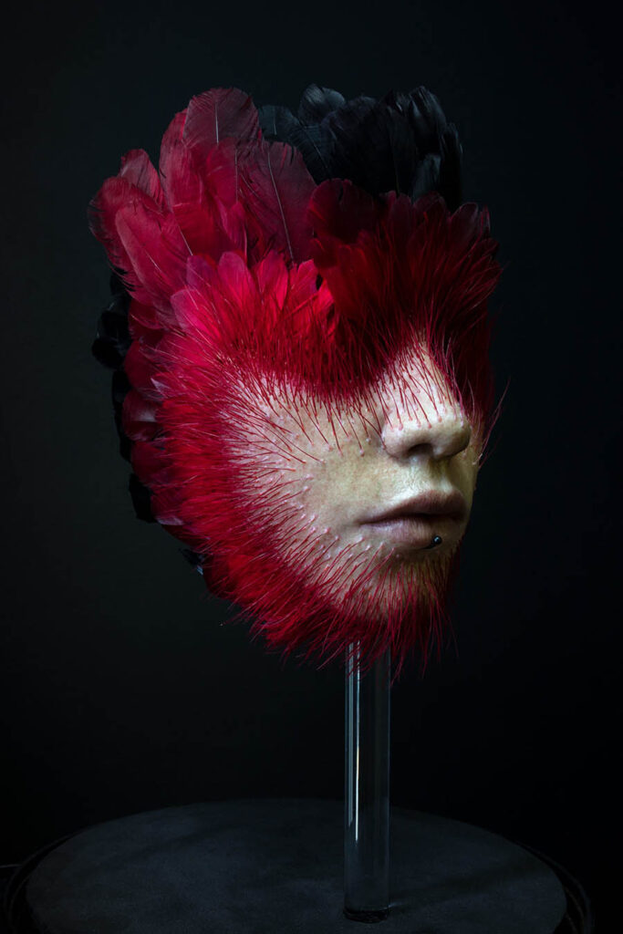 Raciel Romero Jimenez feather head sculpture