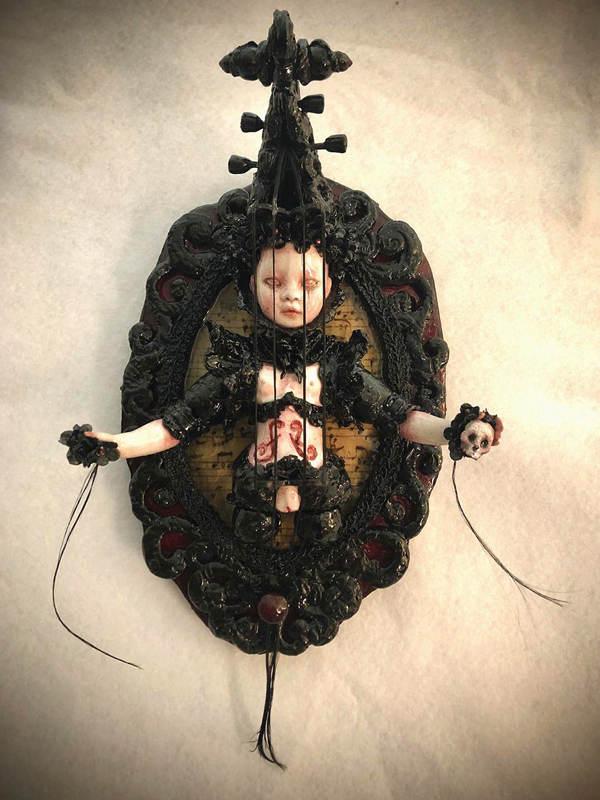 Stefanie Vega black doll sculpture