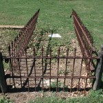 front view of wrought iron fence and wooden post st mary cemetery 2013