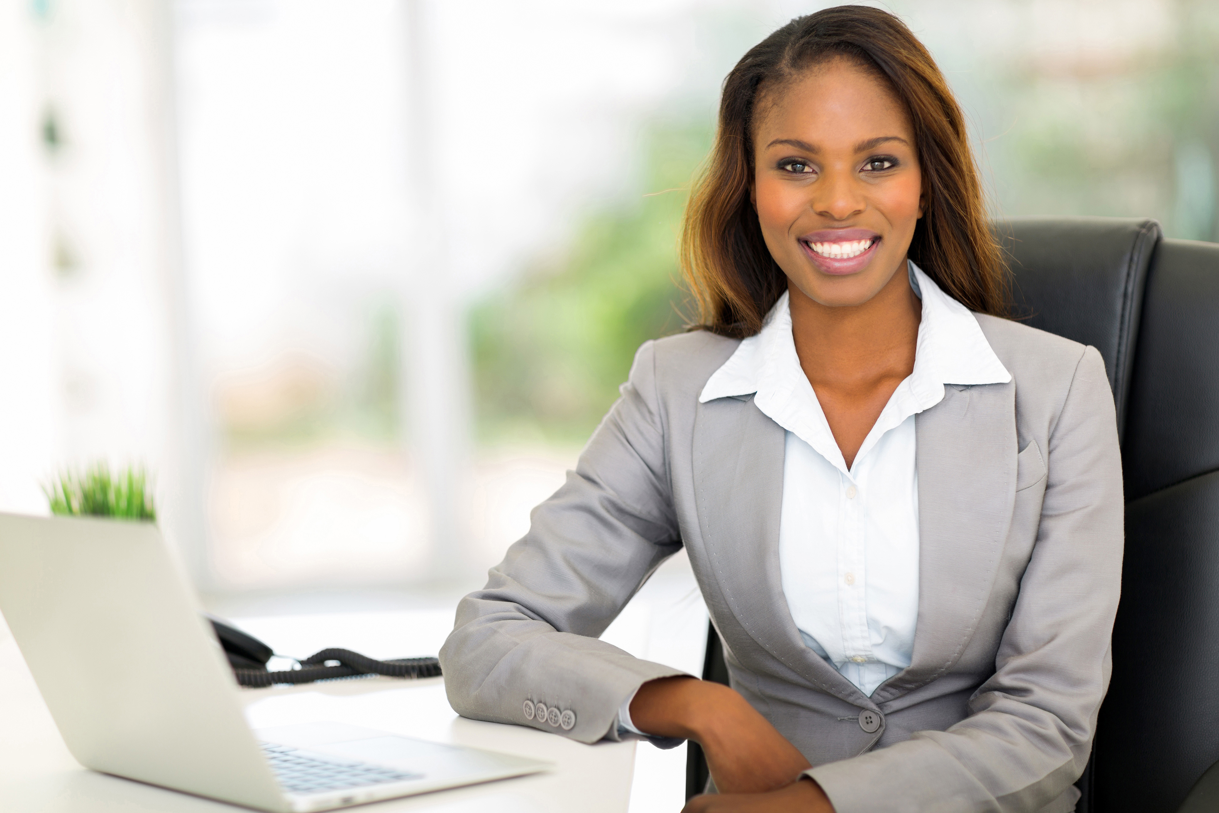 beautiful young afro american businesswoman sitting in office