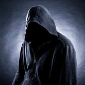 17955070-invisible-man-in-the-hood--black-background