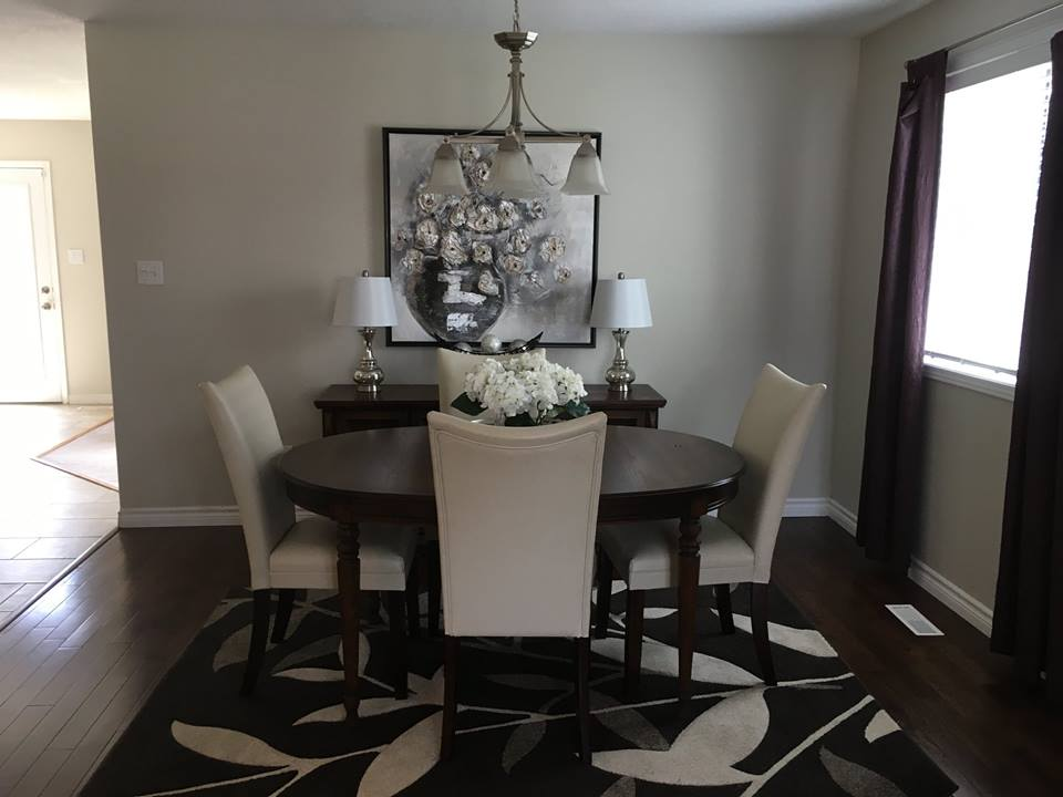 Picture of dining after | A staged living room rich in blues | MatiDesign Interior Decorating And Home Staging London Ontario