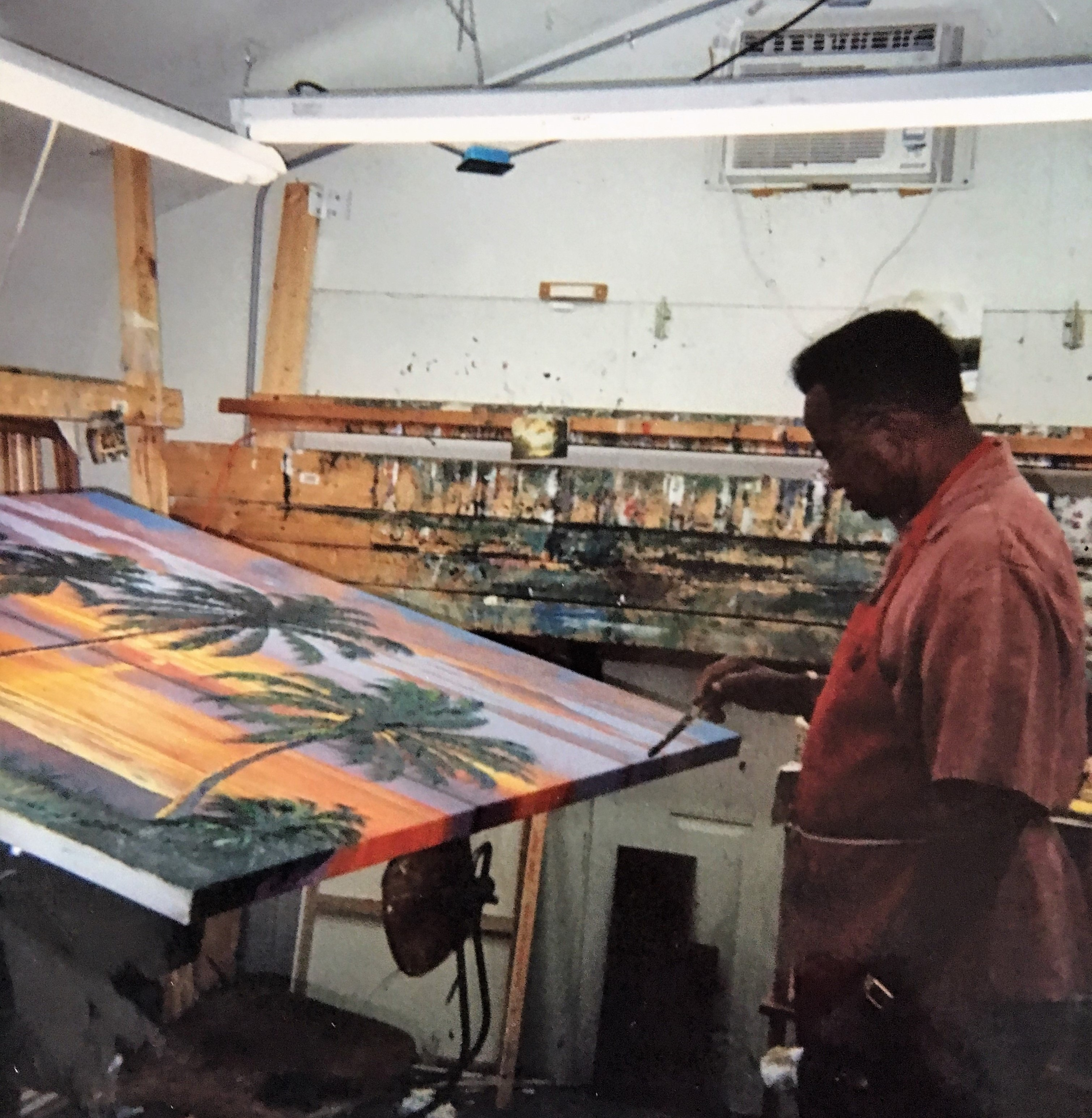 Florida Highwaymen James Gibson teaches AJ Brown to paint in his makeshift studio, was for Florida's Governor Charlie Crist, in January 2008