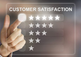 business hand clicking customer satisfaction on virtual screen interface