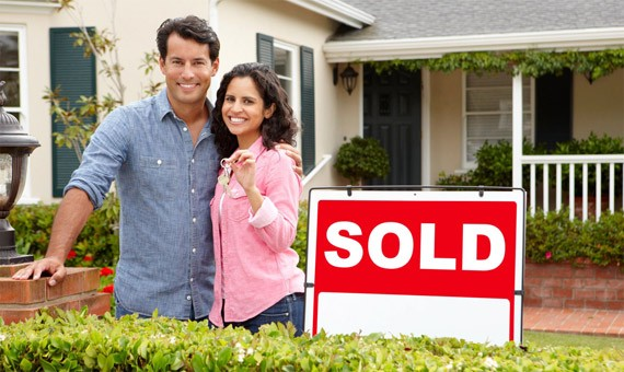 home loan qualification program couple in front of house