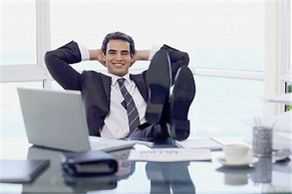 loan officer jobs - best affiliate program - happy affiliate at desk with legs up