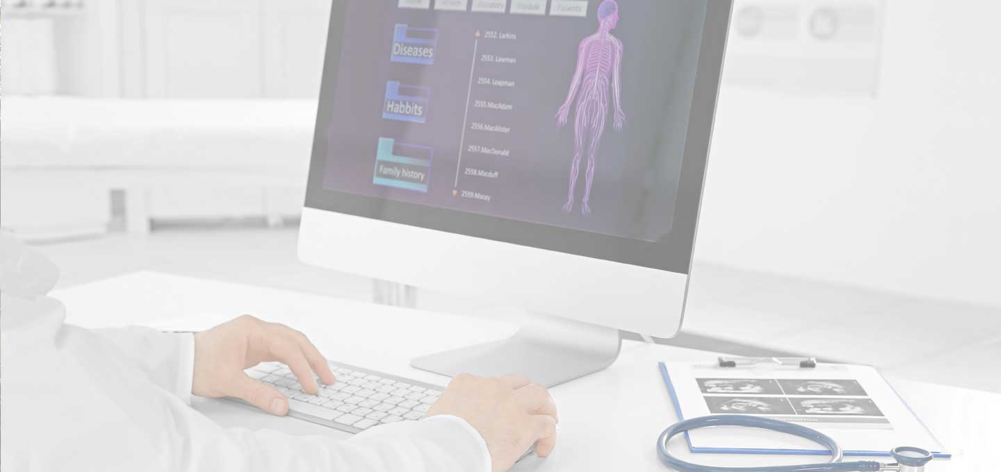 doctor sitting at a computer screen