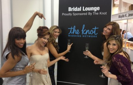 brand launch 5 women in front of a banner that says The Knot.