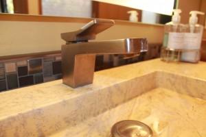 Zucchetti Faucets, Custom  Italian stone sinks, Lighted mirrors made in USA