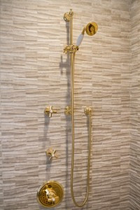 The shiny brass against the highly textured walls is visually interesting