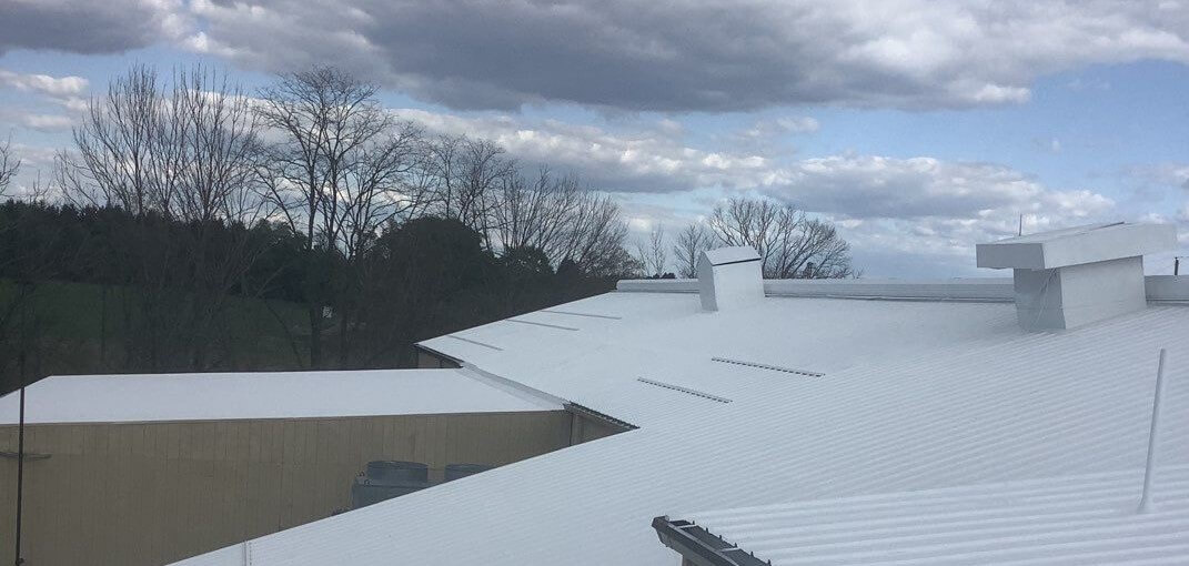 Why Are Flat Roofs Common on Larger Commercial Buildings?