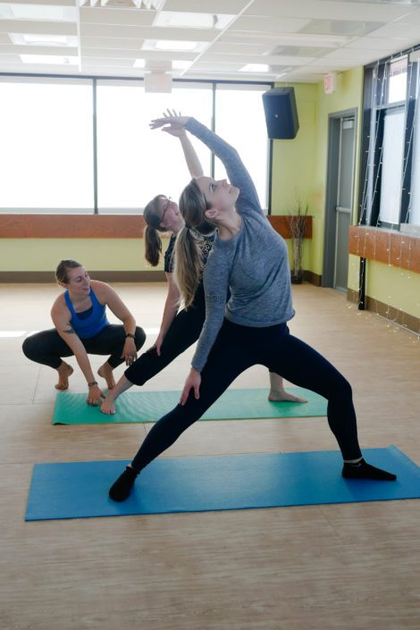 Studio hot yoga class with teacher