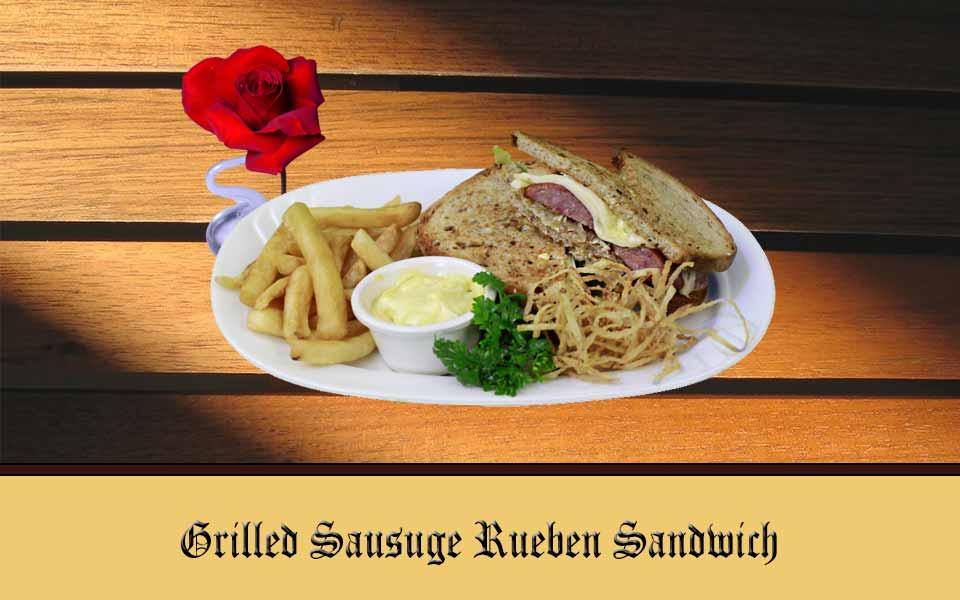 Grilled Sausage Reuben Sandwich - Bratwurst, Sauerkraut, Swiss Cheese on Rye & Fries