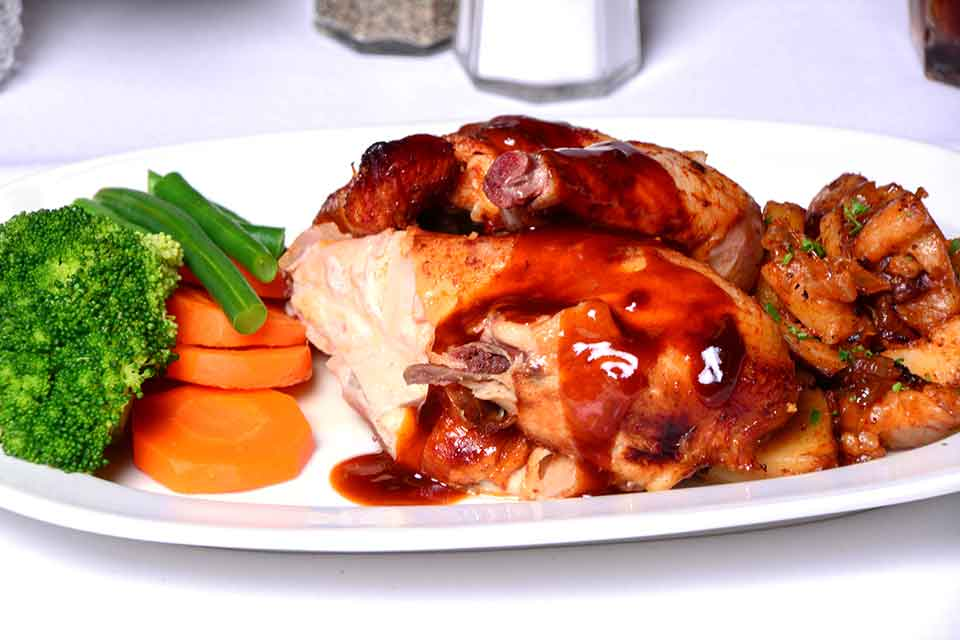 Roast 1/2 chicken served with austrian potato and vegetables
