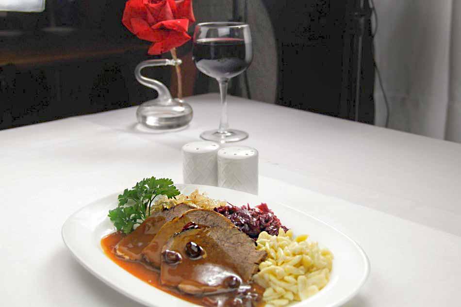 Sauerbraten in Sweet Sour sauce with Spaetzel Red Cabbage and Sauerkraut