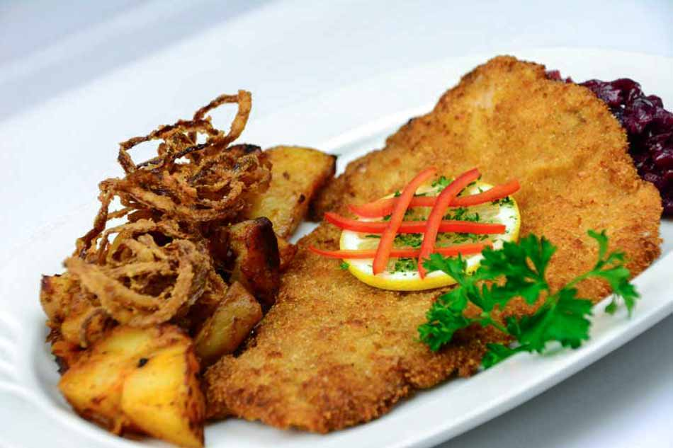 Wiener Schnitzel Veal Cutlet breaded pan fried with Austrian Potatoes, Red Cabbage