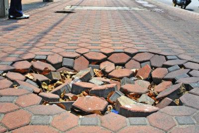 premises liability sidewalk hole