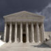 Dark forbidding storm sky over the United States Supreme Court building in Washington DC.