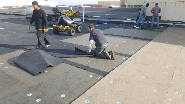 Tri-Star Roofing Team removing more of the old roof